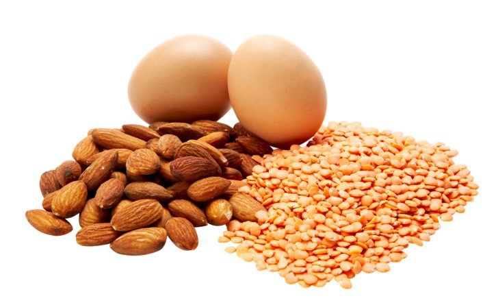 Eggs, almonds, and lentils on white background