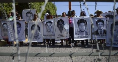 Relatives hold up pictures of some of the 43 missing students of Ayotzinapa College Raul Isidro Burgos during a protest outside at the 27th Infantry Battalion, in Iguala, southern Mexican state of Guerrero, December 18, 2014.  REUTERS/Emiliano Torres