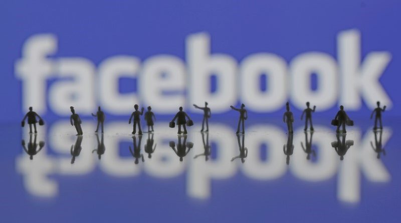 3D-printed models of people are seen in front of a Facebook logo in this photo illustration taken June 9, 2016. REUTERS/Dado Ruvic/Illustration