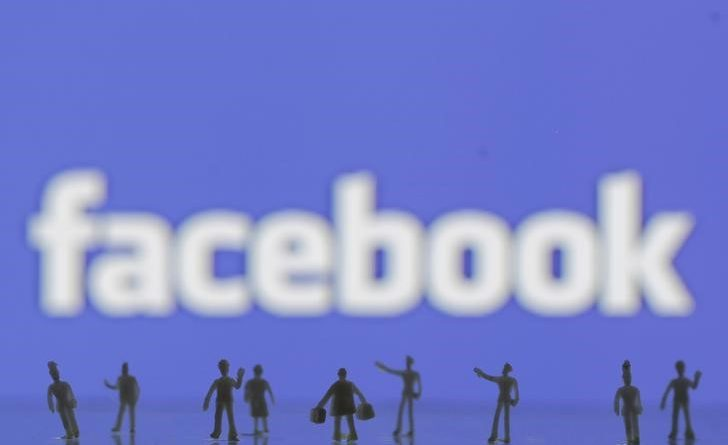 3D-printed models of people are seen in front of a Facebook logo in this photo illustration taken June 9, 2016. REUTERS/Dado Ruvic/Illustration/Files