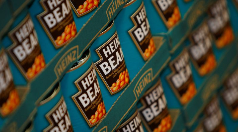 Tins of Heinz Baked Beans rest on a palette in the company's factory in Wigan, Britain, May 21, 2009. REUTERS/Phil Noble/File Photo