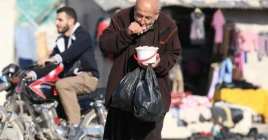 A man eats food that was distributed as aid in a rebel-held besieged area in Aleppo, Syria November 6, 2016. REUTERS/Abdalrhman Ismail