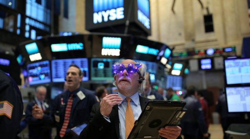 """A trader wears glasses that say """"2017"""" ahead of the new year on the floor of the New York Stock Exchange (NYSE) in Manhattan, New York City, U.S., December 30, 2016. REUTERS/Stephen Yang"""