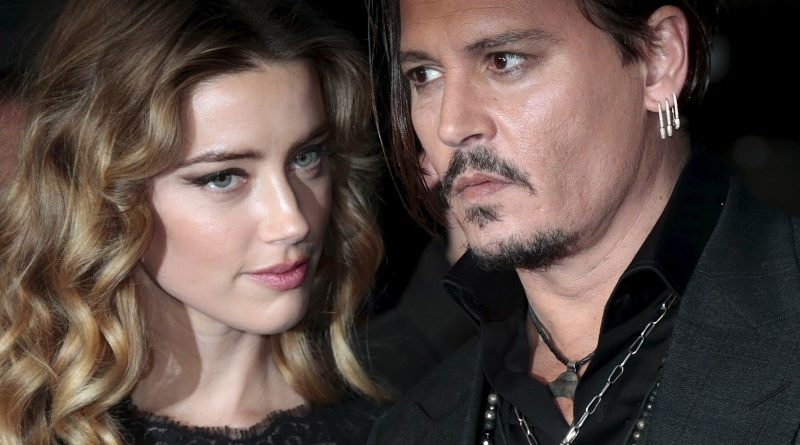 """Cast member Johnny Depp and his actress wife Amber Heard arrive for the British premiere of the film """"Black Mass"""" in London, Britain October 11, 2015. REUTERS/Suzanne Plunkett/Files"""