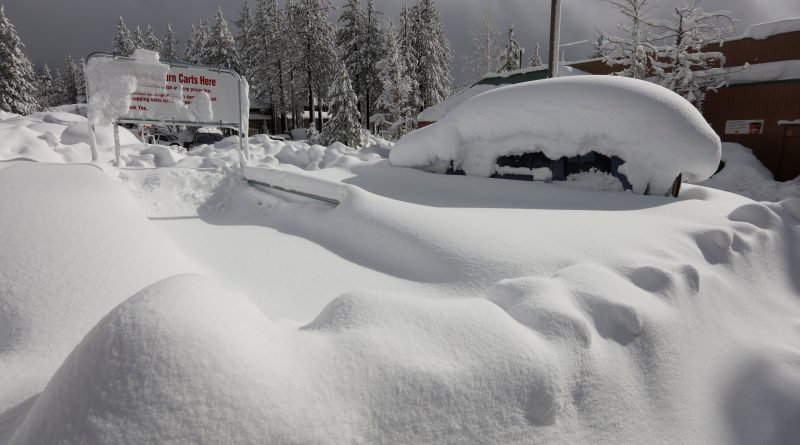 A car is buried in snow in a parking lot after a heavy winter storm in Incline Village, Nevada, U.S. January 11, 2017   REUTERS/Bob Strong