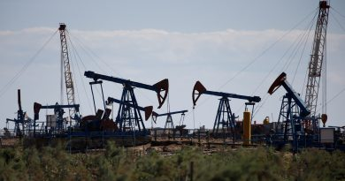 Oil prices settle up on demand forecasts, Kurdistan tensions