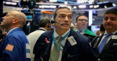 Global stocks rise on earnings while bonds, dollar fall