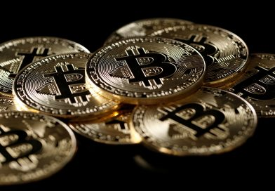 Bitcoin futures make firm debut, dollar holds gains ahead of Fed